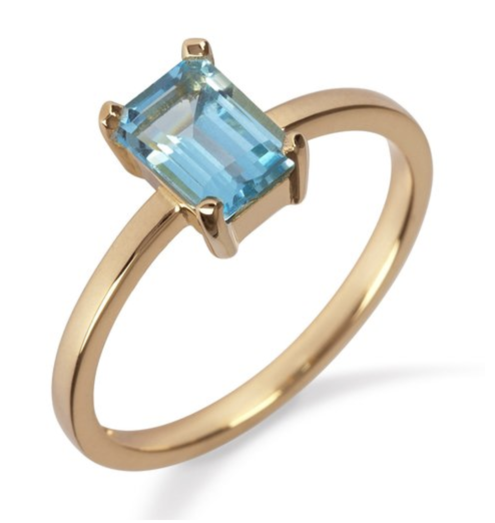 18K yellow gold ring with blue topaz, €695 at momuse.ie