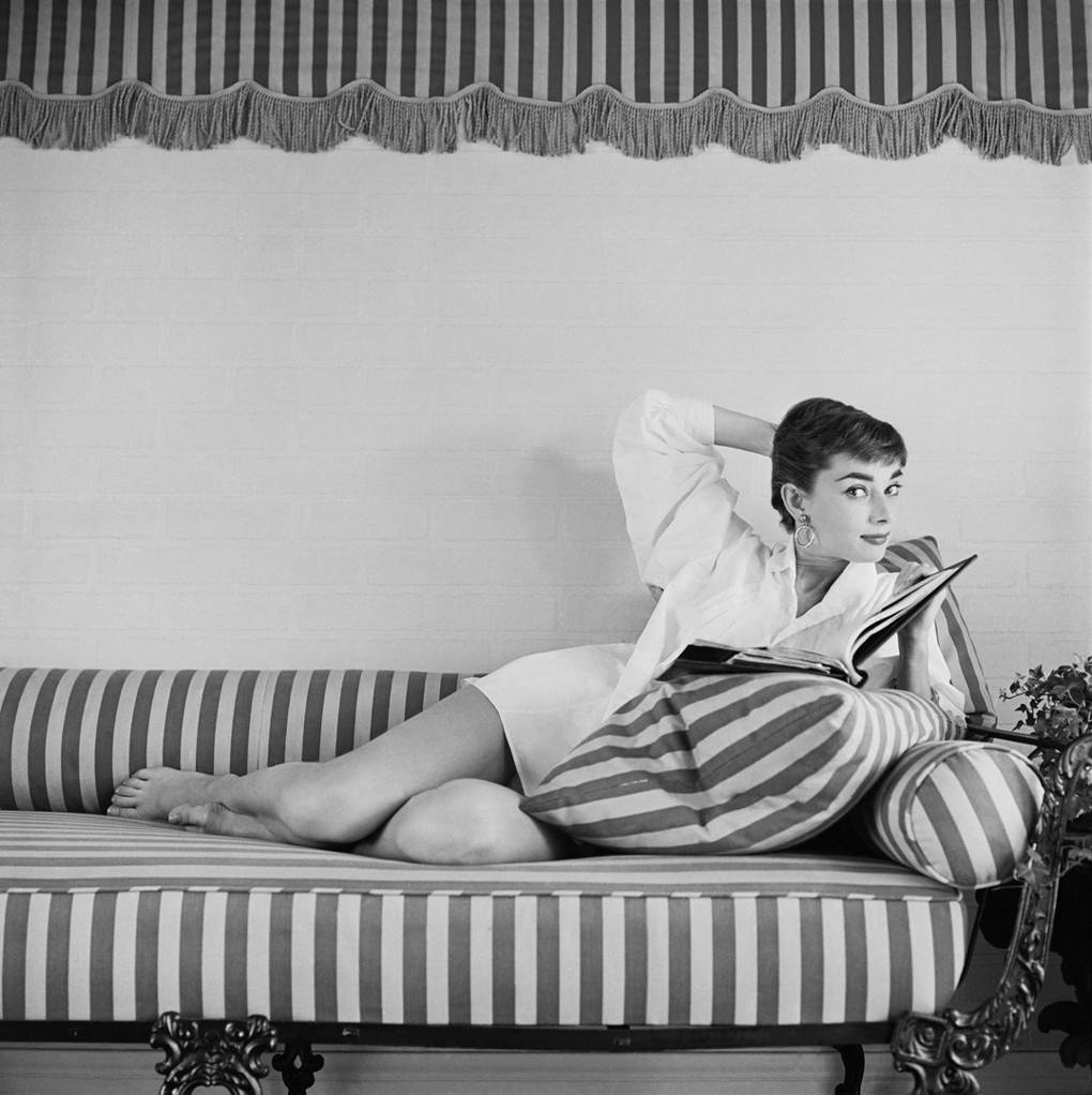Audrey Hepburn on a striped lounger by Mark Shaw, €671.80