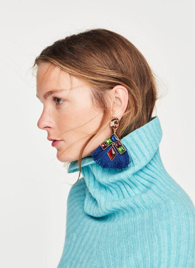 Polo neck sweater, €99, fringe rhinestone earrings, €49, both at uterque.com
