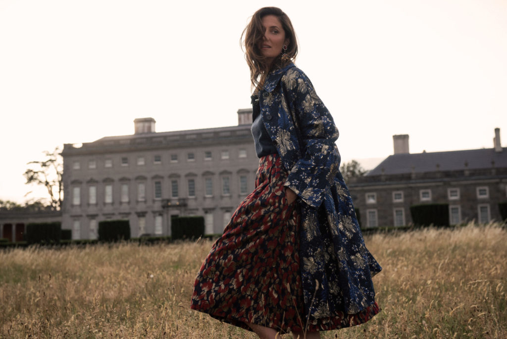 Lurex knit, €59 at stories.com, brocade skirt by Tara Jarmon, €320 at arnotts.ie, brocade coat by Dries Van Noten, €1,495, Star& Bee drop earrings by Thot Gioielli, €24o; both at brownthomas.com