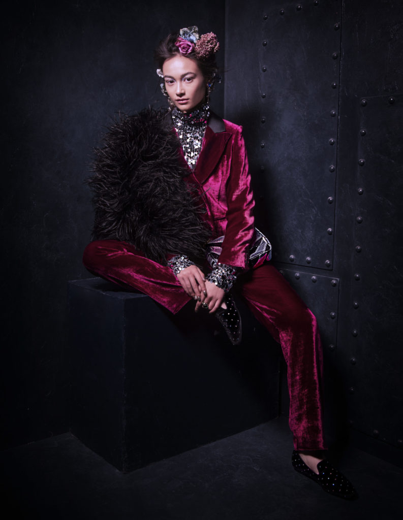 Pink velvet jacket, €450; pink velvet trousers, €320; both Masscob; sequin polo MM6 Maison Margiela, €380; all at Beautiful South. Earrings by Philippe Ferrandis, €115; ring by Thot Gioiello, €135; sequin bag by Tom Ford, €2,45; all at Brown Thomas, flat black velvet shoes by Kurt Geiger, €150 at Arnotts, black feather jacket by Paula Ka, €1,845 at Samui.